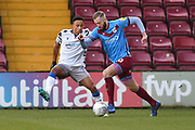 Scunthorpe United player Kevin van Veen (10) and Colchester United player Cohen Bramall(3) during the EFL Sky Bet League 2 match between Scunthorpe United and Colchester United at Glanford Park, Scunthorpe, England on 14 December 2019.