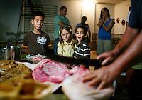 Making lechon, or roasted pig, in Jayuya, Puerto Rico
