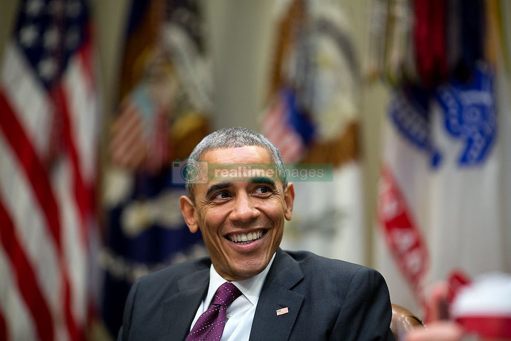 President Barack Obama laughs during a meeting in the Roosevelt Room of the White House, Nov. 17, 2014. (Official White House Photo by Pete Souza)<br /> <br /> This official White House photograph is being made available only for publication by news organizations and/or for personal use printing by the subject(s) of the photograph. The photograph may not be manipulated in any way and may not be used in commercial or political materials, advertisements, emails, products, promotions that in any way suggests approval or endorsement of the President, the First Family, or the White House.
