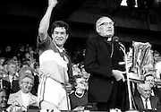 Winners of the All Ireland minor hurling final, Offaly defeated Cork with a score of 3-12 to 3-9. Here the victorious Offaly captain, Michael Hogan, is about to receive the Irish Press Cup from Dr T Morris, Archbishop of Cashel.<br />