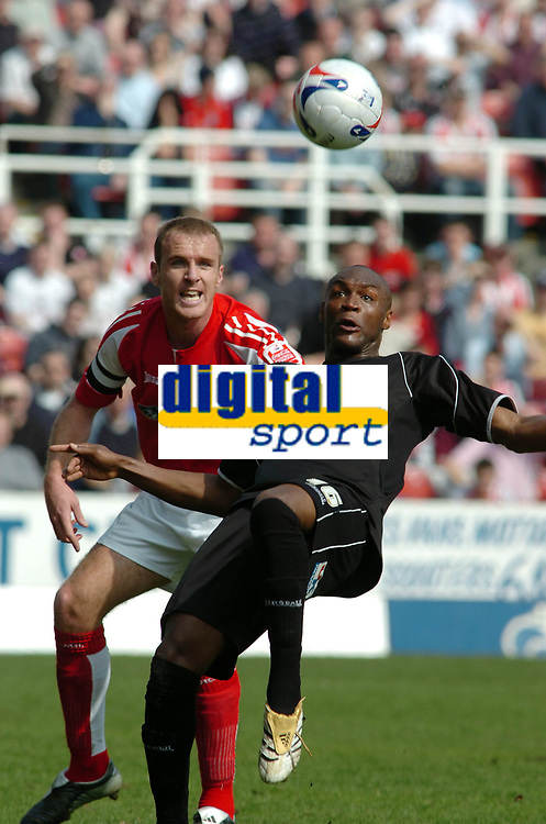 Photo: Kevin Poolman.<br />Swindon Town v Brentford. Coca Cola League 1. 22/04/2006. Brentford's Marcus Gayle gets to the ball before Kevin O'Connor.
