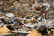 Tapha Dieng, 5, rummages through garbage to find items to play with or sell near his home in the Medina Gounass neighborhood of Guediawaye, Senegal on  Friday May 1, 2009.  (Olivier Asselin for the New York Times).