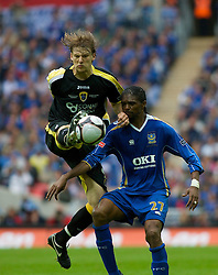 LONDON, ENGLAND - Saturday, May 17, 2008: Cardiff City's Glen Loovens and Portsmouth's Nwankwo Kanu during the FA Cup Final at Wembley Stadium. (Photo by Chris Ratcliffe/Propaganda)