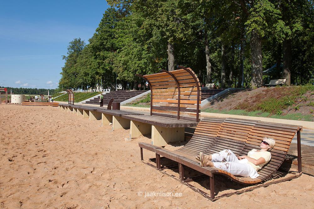 Young Woman Lying on Beach Chair,  Promenade by Lake Tamula in Võru, Estonia