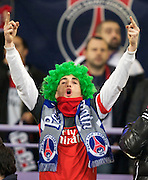 A charming PSG fan sporting a green wig gestures to the Toulouse fans. Toulouse v Paris St Germain, Ligue 1, Stade Municipal, Toulouse, France, 1st Feb 2013..Credit - Eoin Mundow/Cleva Media, www.clevamedia.com