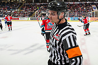 KELOWNA, BC - OCTOBER 16:  Referee Corey Koop skates to teh bench of the Swift Current Broncos at the Kelowna Rockets at Prospera Place on October 16, 2019 in Kelowna, Canada. (Photo by Marissa Baecker/Shoot the Breeze)