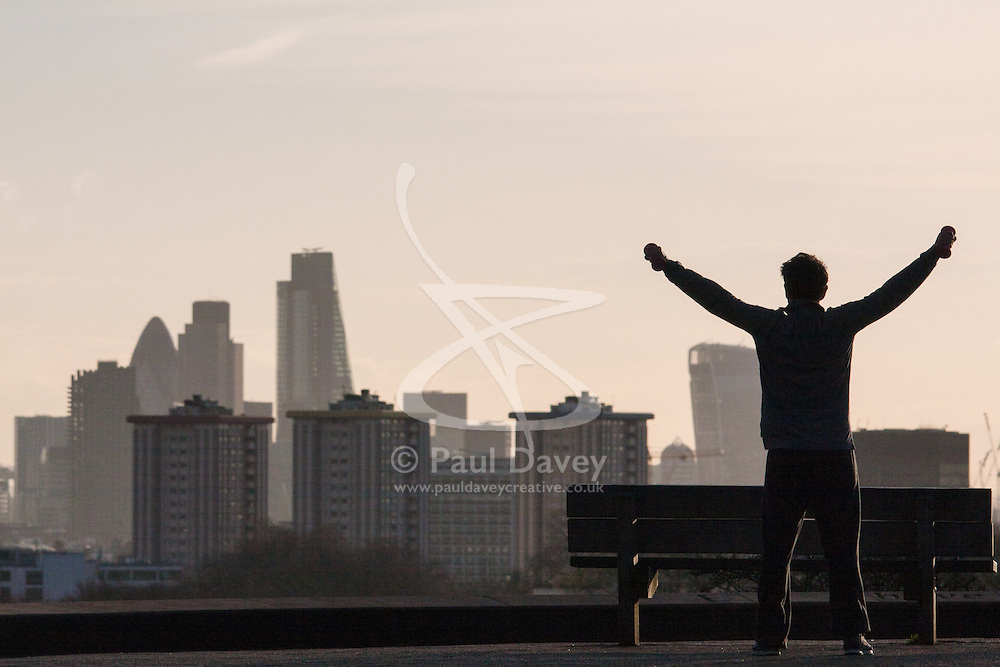 December 11th 2014. A man exercises on top of Primrose Hill as sunrise greets London ahead of a day of unsettled weather.