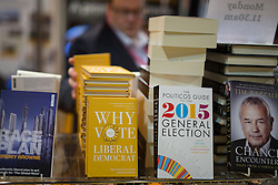 "© Licensed to London News Pictures . 04/10/2014 . Glasgow , UK . "" Why vote Liberal Democrat "" for sale in the exhibition hall at the conference . The Liberal Democrat Party Conference 2014 at the Scottish Exhibition and Conference Centre in Glasgow . Photo credit : Joel Goodman/LNP"