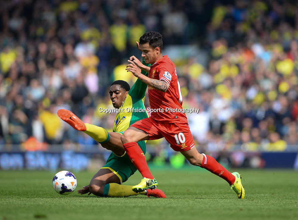 20 April 2014 - Barclays Premier League - Norwich City v Liverpool - Philippe Coutinho of Liverpool in action with Leroy Fer of Norwich City - Photo: Marc Atkins / Offside.