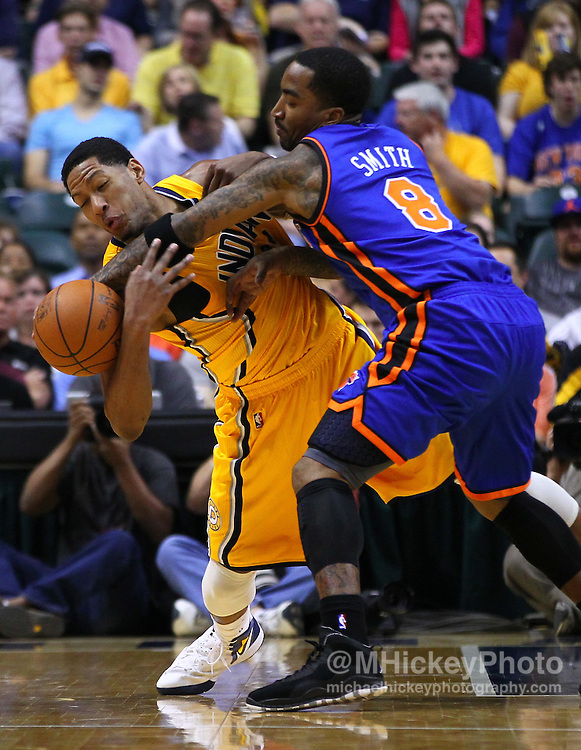 April 03, 2012; Indianapolis, IN, USA; Indiana Pacers small forward Danny Granger (33) and New York Knicks shooting guard J.R. Smith (8) fight for a loose ball at Bankers Life Fieldhouse. Mandatory credit: Michael Hickey-US PRESSWIRE