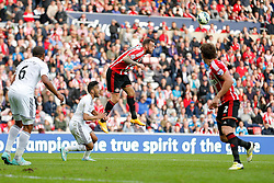 Steven Fletcher of Sunderland heads the ball - Photo mandatory by-line: Rogan Thomson/JMP - 07966 386802 - 27/08/2014 - SPORT - FOOTBALL - Sunderland, England - Stadium of Light - Sunderland v Swansea City - Barclays Premier League.