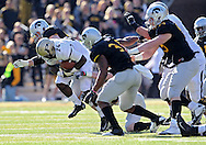 November 10 2012: Purdue Boilermakers running back Akeem Shavers (24) is hit by Iowa Hawkeyes linebacker James Morris (44) during the NCAA football game between the Purdue Boilermakers and the Iowa Hawkeyes at Kinnick Stadium in Iowa City, Iowa on Saturday, November 10, 2012. Purdue defeated Iowa 27-24.