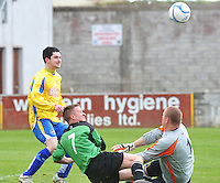 St Bernards Brian McDonnell saves with the help of Padraig King  to deny Niall O Grady, Oranbay  in Terryland. Photo:Andrew Downes