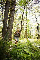 A woman hiking in a forest.