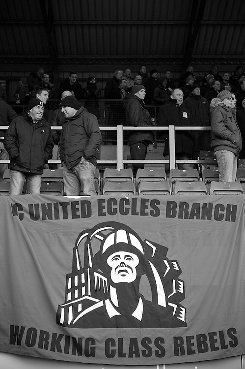 FC United of Manchester play a local team Chorley at Bury football club's ground in Lancashire, Britain. Photo shows a banner on the terraces.