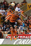 Wolverhampton Wanderers defender Matt Doherty (2) Wolverhampton Wanderers midfielder George Saville (8) and Reading striker Yann Kermorgant (18) challenge for a header during the EFL Sky Bet Championship match between Wolverhampton Wanderers and Reading at Molineux, Wolverhampton, England on 13 August 2016. Photo by Alan Franklin.