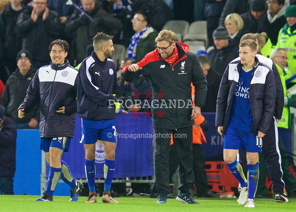 LEICESTER, ENGLAND - Monday, February 1, 2016: Liverpool's manager Jürgen Klopp shares a joke with Leicester City's Riyad Mahrez despite losing 2-0 during the Premier League match at Filbert Way. (Pic by David Rawcliffe/Propaganda)