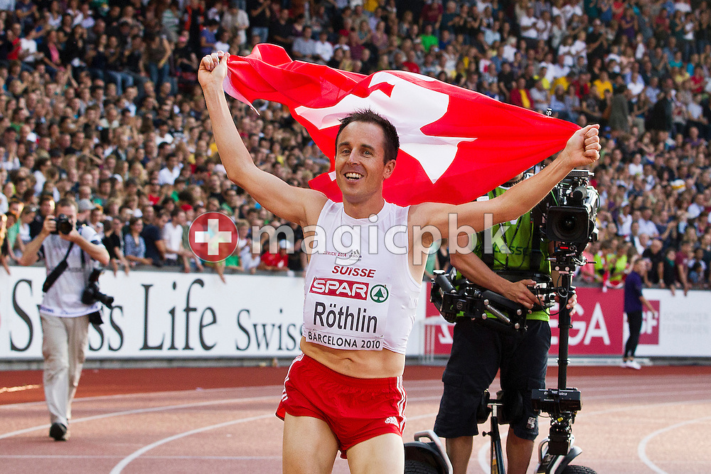 Viktor Roethlin of Switzerland holds a flog on his lap of honor during the IAAF Diamond League meeting at the Letzigrund Stadium in Zurich, Switzerland, Thursday, Aug. 19, 2010. (Photo by Patrick B. Kraemer / MAGICPBK)