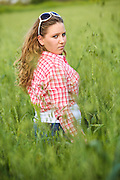 Portrait of a 16 year old teen girl in a wheat field Model released