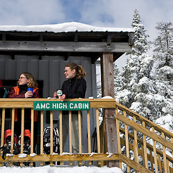 Three women enjoy the morning on the front porch of the Appalachian Mountain Club's Hi-Cabin on Mount Cardigan in Canaan, NH.  Hurricane Gap Trail.