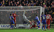 AFC Wimbledon Sean Rigg attempt is tipped over by Liverpool Simon Mignolet during the The FA Cup match between AFC Wimbledon and Liverpool at the Cherry Red Records Stadium, Kingston, England on 5 January 2015. Photo by Phil Duncan.