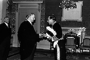 13/02/1964<br /> 02/13/1964<br /> 13 February 1964<br /> British Ambassador presents Credentials at Aras an Uachtarain. Picture shows Sir Geofroy Tory, K.C.M.G., the new ambassador presenting his credentials to President Eamon de Valera (left) during the ceremony.