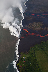 2018 05 24 - Pahoa, Hawaii, USA:  Two rivers of lava  enter the sea this morning, as multiple fissure eruptions supplied a tremendous volume of molten material, and the interaction between the cold seawater and 2000 degree lava create a toxic gas plume of laze.  Consisting of hydrochloric acid, steam, and tiny bits of volcanic glass, this mixture irritates and burns, and can cause respiratory issues.<br />