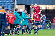 Keith Earls (#11) of Munster Rugby is lifted by Niall Scannell (#2) of Munster Rugby at the final whistle of the Heineken Champions Cup quarter-final match between Edinburgh Rugby and Munster Rugby at BT Murrayfield Stadium, Edinburgh, Scotland on 30 March 2019.