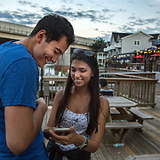 OCCOQUAN, VA - AUG4: Andres Alvarez, 24, and Mahum Khalid, 24, play Pokemon Go along the waterfront in Occoquan, Virginia, August 4th, 2016. This sleepy Virginia town has become a hotspot for Pokemon Go. Throughout the night, kids and young adults play the game on the streets, leaving beer bottles and litter behind. A few residents have complained to city hall and now the city is hiring extra police officers to handle the new masses. (Photo by Evelyn Hockstein/For The Washington Post)