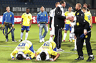 Onderwerp/Subject: Cambuur Leeuwarden - Jupiler League<br /> Reklame:  <br /> Club/Team/Country: <br /> Seizoen/Season: 2012/2013<br /> FOTO/PHOTO: Adnane TIGHADOUINI (ON GROUND) of Cambuur Leeuwarden and Mohamed EL MAKRINI (ON GROUND) of Cambuur Leeuwarden thanking to Allah and Material Man Siep LIJZENGA (R) of Cambuur Leeuwarden celebrating after the match. (Photo by PICS UNITED)<br /> <br /> Trefwoorden/Keywords: <br /> #02 #03 $94 &plusmn;1367598354739 &plusmn;1367598354739<br /> Photo- &amp; Copyrights &copy; PICS UNITED <br /> P.O. Box 7164 - 5605 BE  EINDHOVEN (THE NETHERLANDS) <br /> Phone +31 (0)40 296 28 00 <br /> Fax +31 (0) 40 248 47 43 <br /> http://www.pics-united.com <br /> e-mail : sales@pics-united.com (If you would like to raise any issues regarding any aspects of products / service of PICS UNITED) or <br /> e-mail : sales@pics-united.com   <br /> <br /> ATTENTIE: <br /> Publicatie ook bij aanbieding door derden is slechts toegestaan na verkregen toestemming van Pics United. <br /> VOLLEDIGE NAAMSVERMELDING IS VERPLICHT! (&copy; PICS UNITED/Naam Fotograaf, zie veld 4 van de bestandsinfo 'credits') <br /> ATTENTION:  <br /> &copy; Pics United. Reproduction/publication of this photo by any parties is only permitted after authorisation is sought and obtained from  PICS UNITED- THE NETHERLANDS