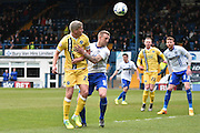 Bury Defender, Peter Clarke and Millwall Forward, Steve Morison battle during the Sky Bet League 1 match between Bury and Millwall at the JD Stadium, Bury, England on 23 April 2016. Photo by Mark Pollitt.