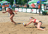 STARE JABLONKI POLAND - July 3: Barbara Hansel /1/ and Katharina Schutenhofer of Austria in action during Day 3 of the FIVB Beach Volleyball World Championships on July 3, 2013 in Stare Jablonki Poland.  (Photo by Piotr Hawalej)