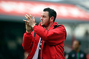 Bristol City striker, Lee Tomlin (9) applauding fans during the Sky Bet Championship match between Brentford and Bristol City at Griffin Park, London, England on 16 April 2016. Photo by Matthew Redman.