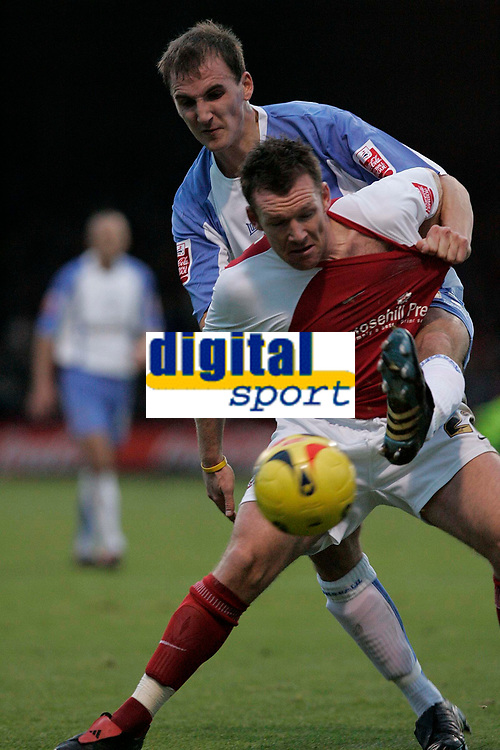 Photo: Dave Howarth.<br />Rotherham United v Swindon Town. Coca Cola League 1.<br />03/12/2005. Swindon's Andrew Nicholas battles with Rotherham's Paul Evans