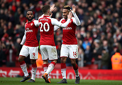 Arsenal's Pierre-Emerick Aubameyang (right) celebrates scoring his side's second goal of the game during the Premier League match at The Emirates Stadium, London.