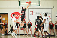 Rutland's Nathaniel Kingsley (25) leaps to grab the rebound during the boys high school semi final basketball game between the Rutland Raiders and the Rice Green Knights at Patrick Gym on Saturday afternoon February 27, 2016 in Burlington. (BRIAN JENKINS/for the FREE PRESS)