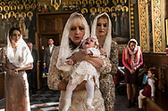 Alisa, age three months, cries in the arms of her grandmother during her baptism at the Life Spring Church at the Kyiv-Pechersk Lavra on Saturday, October 6, 2018 in Kyiv, Ukraine.