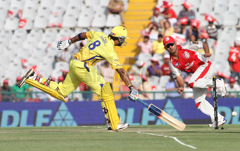 Murali Vijay of the Chennai Super Kings scrambles to make his ground during match 9 of the Indian Premier League ( IPL ) Season 4 between the Kings XI Punjab and the Chennai Super Kings held at the PCA stadium in Mohali, Chandigarh, India on the 13th April 2011..Photo by Shaun Roy/BCCI/SPORTZPICS