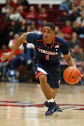 November 18, 2010; Stanford, CA, USA;  Virginia Cavaliers guard Jontel Evans (1) dribbles the ball against the Stanford Cardinal during the first half at Maples Pavilion.