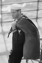 Sailor carrying his duffle bag, (b&w)