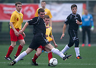 SO Poland (black) compete with SO Russia (yellow) during the 2013 Special Olympics European Unified Football Tournament in Warsaw, Poland.<br /> <br /> Poland, Warsaw, June 06, 2012<br /> <br /> Picture also available in RAW (NEF) or TIFF format on special request.<br /> <br /> For editorial use only. Any commercial or promotional use requires permission.<br /> <br /> <br /> Mandatory credit:<br /> Photo by © Adam Nurkiewicz / Mediasport