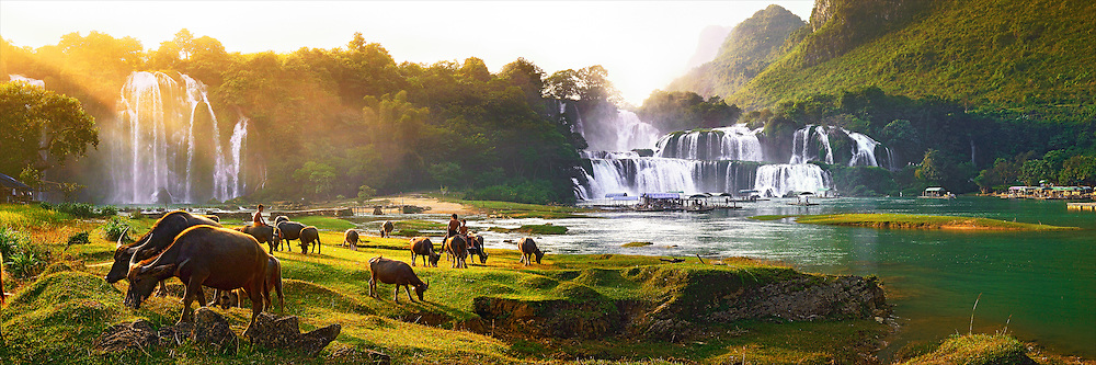 Vietnam Images-landscape-Ban Gioc waterfall in the autumn<br /> North Vietnam. Boys playing with their animals after harvesting the crops