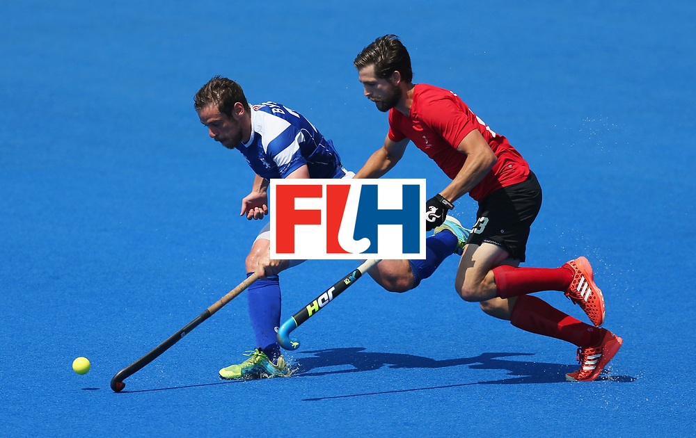 LONDON, ENGLAND - JUNE 20:  Gavin Byers of Scotland and Iain Smythe of Canada battle for the ball during the Pool B match between Scotland and Canada on day six of the Hero Hockey World League Semi-Final at Lee Valley Hockey and Tennis Centre on June 20, 2017 in London, England.  (Photo by Alex Morton/Getty Images)