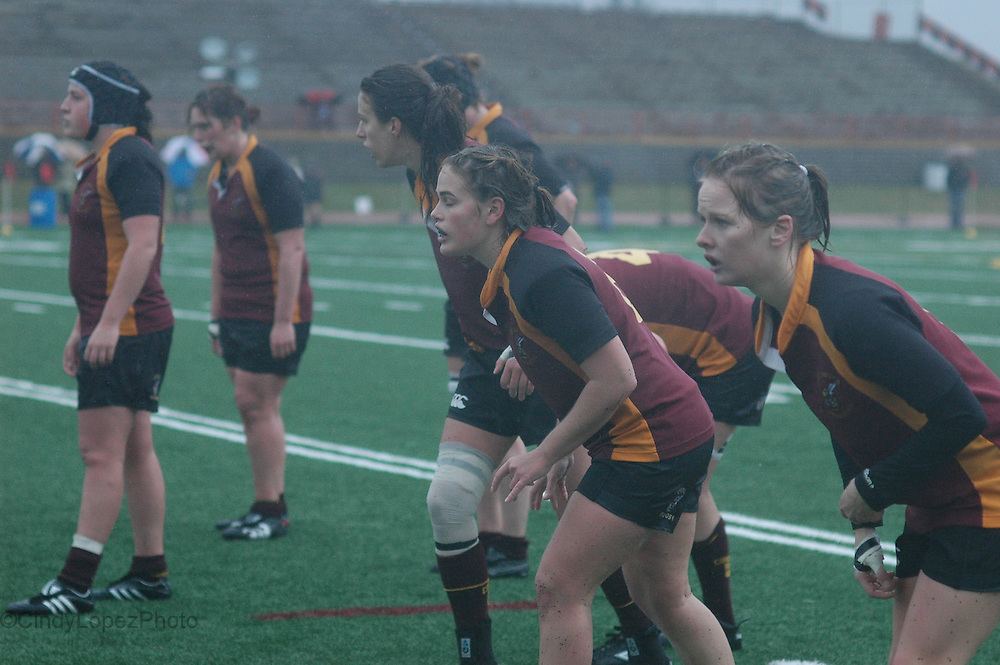 The Concordia Stingers Women's rugby team keep focus in wet conditions in the RSEQ final against the Laval Rouge et Or. (October 2010).