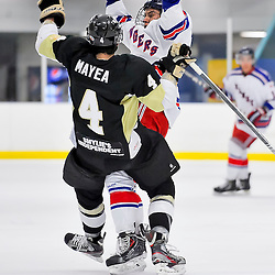NORTH YORK, ON - Feb 9 : Ontario Junior Hockey League Game Action between North York Rangers Hockey Club and the Trenton Golden Hawks Hockey Club.  Tyler Mayea #4 of the Trenton Golden Hawks Hockey Club takes the hit from North York Rangers Hockey Club player.<br /> (Photo by Phillip Sutherland / OJHL Images)