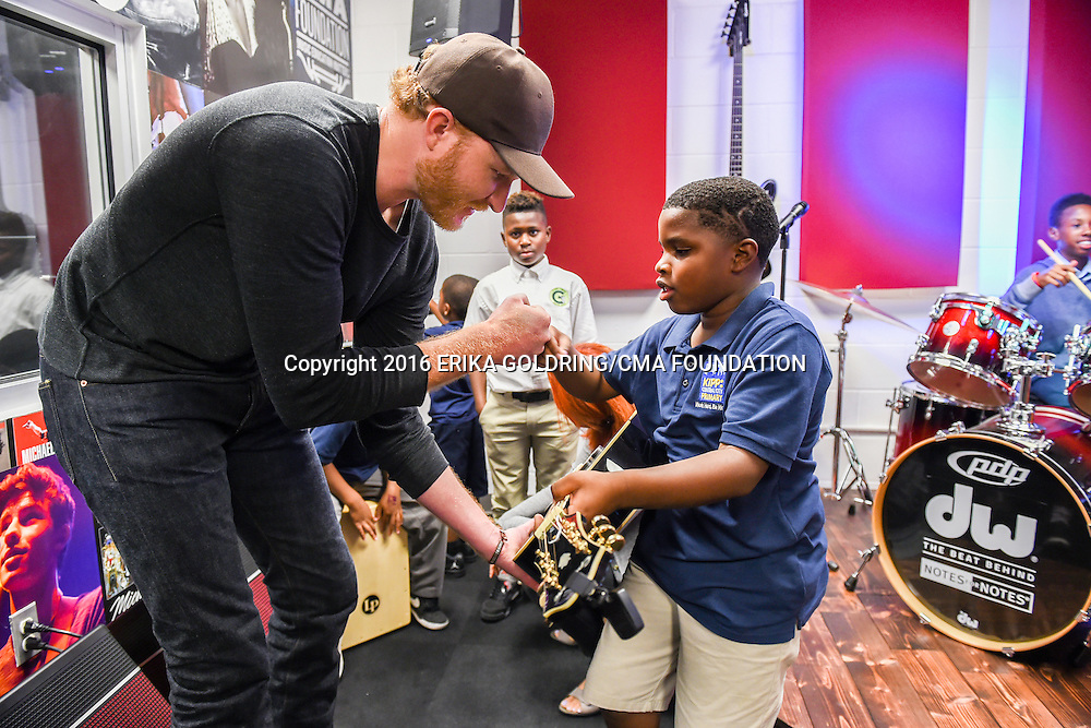 Eric Paslay, a country music singer songwriter talks guitar with KIPP Central City Primary School students at the NOLA Notes for Notes® Studio at the NFL-YET Clubhouse on September 6, 2016.