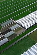 Nederland, Zuid-Holland, Gemeente  Kaag en Braassem, 09-04-2014; Woubrugge, kassen en kwekerijen, omgeven door weiland in het Groene Hart.<br /> Greenhouses, nurseries and fields in the Green Heart (West-Holland).<br /> luchtfoto (toeslag op standaard tarieven);<br /> aerial photo (additional fee required);<br /> copyright foto/photo Siebe Swart.