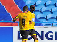 Adebayo Azeez of AFC Wimbledon (right) is congratulated by Matt Tubbs of AFC Wimbledon after scoring the equalizer during the Sky Bet League 2 match at Brunton Park, Carlisle<br /> Picture by Greg Kwasnik/Focus Images Ltd +44 7902 021456<br /> 06/09/2014