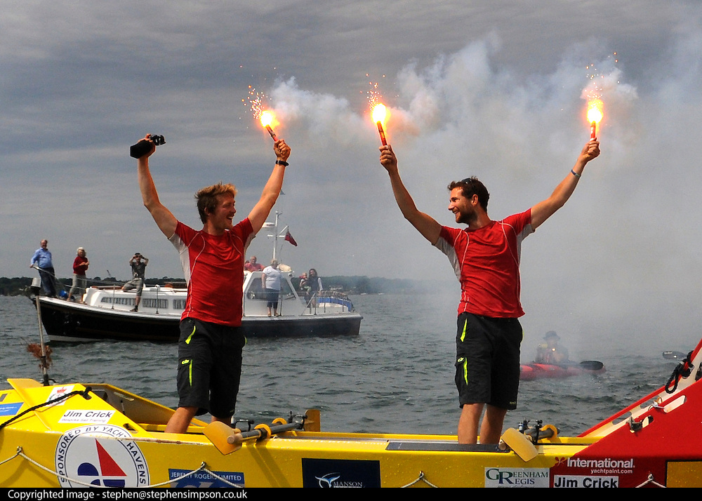 UNITED KINGDOM-LYMINGTON.  Army Doctors, Nick Dennison (R)and Hamish Reid (L) cross the finishing line in the Solent near Lymington after setting a world record for rowing non-stop around the British Isles to raise money for Help for Heroes and the Army Benevolent Fund.. 01/07/2010. STEPHEN SIMPSON...