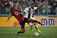 Domenico Criscito of Genoa and Douglas Costa of Juventus compete for the ball during the Serie A 2018/2019 football match between Juventus and Genoa CFC at Allianz Stadium, Turin, October, 20, 2018 <br />  Foto Andrea Staccioli / Insidefoto